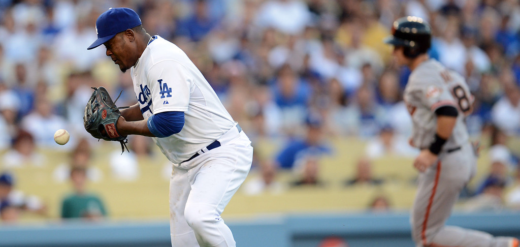 . The Dodgers\' Juan Uribe #5 bobbles the ball and records an error during their game against the Giants at Dodgers Stadium Saturday, September 14, 2013. (Photo by Hans Gutknecht/Los Angeles Daily News)