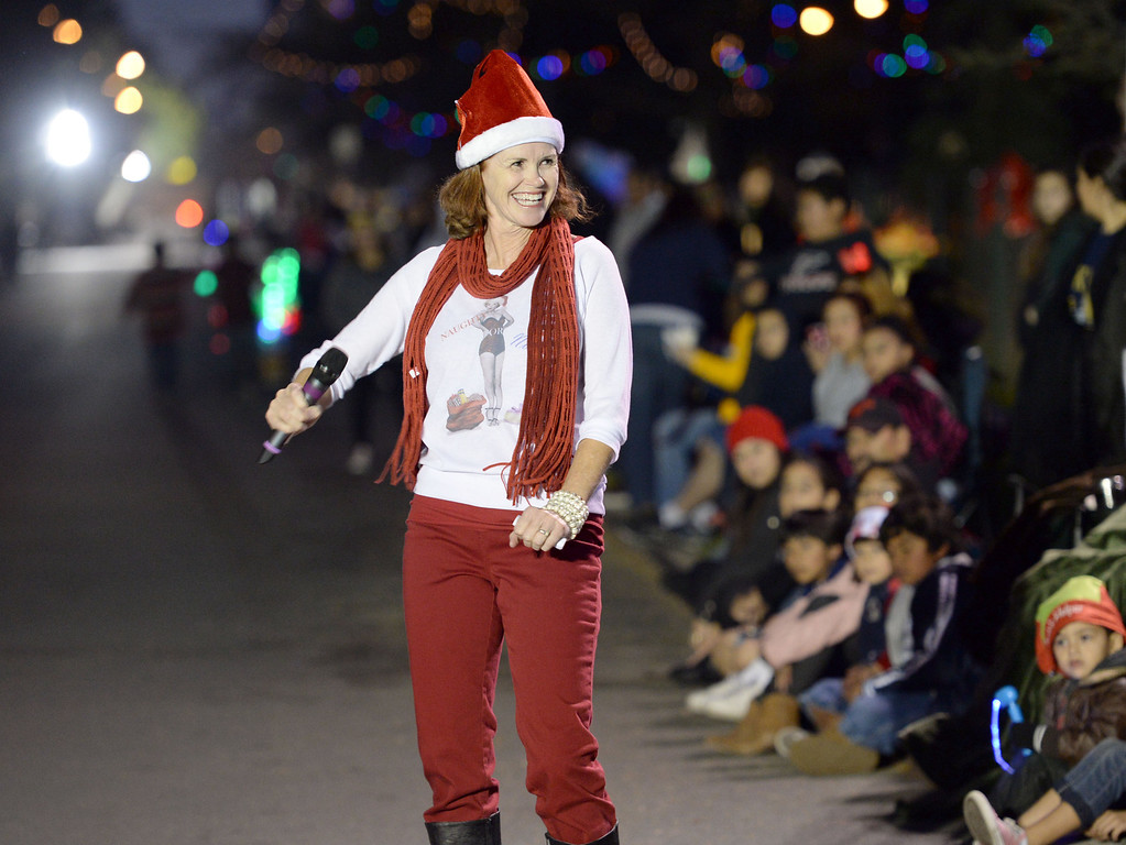 . The 60th annual Daisy Avenue Parade in the Wrigley neighborhood Saturday, December 13, 2013, in Long Beach, CA.  Emcee Jonda Coman hypes-up the crowd during the parade. Photo by Steve McCrank/DailyBreeze