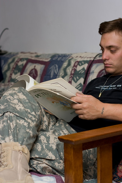 Soldier, reading Peter Rabbit.