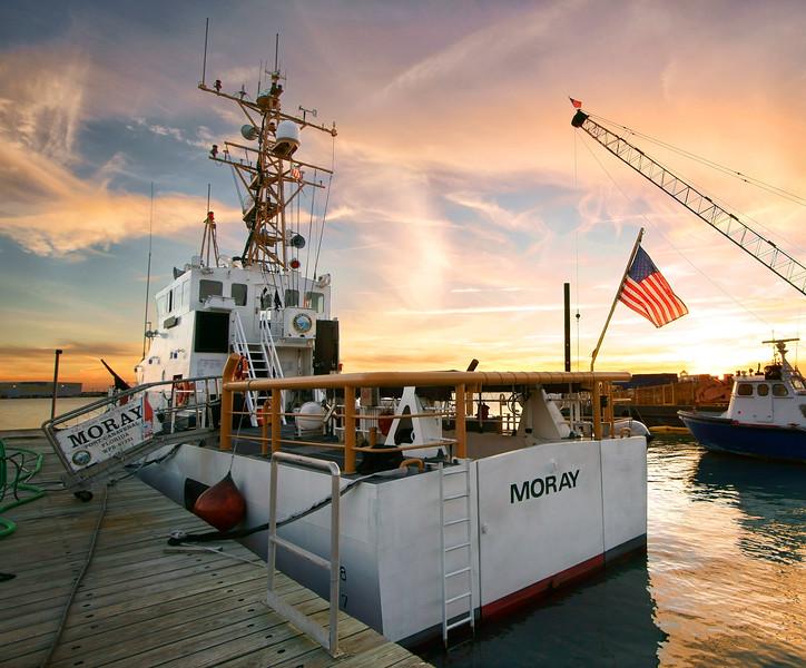 U.S. Coast Guard Cutter Moray at sunset.