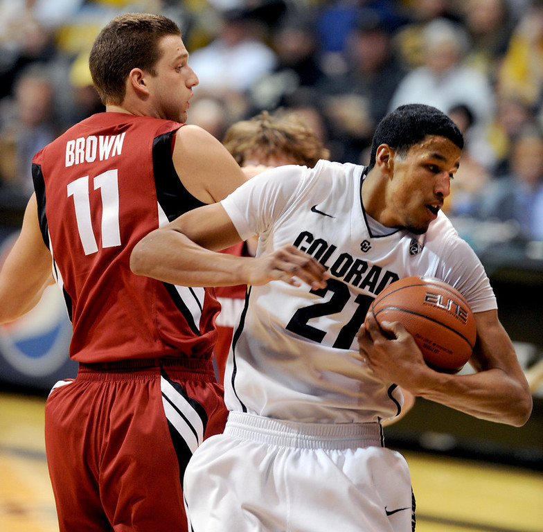 . Andre Roberson of Colorado (21) gets a rebound in front of Andy Brown of Stanford, during the first half of the January 24th, 2013 game in Boulder. Cliff Grassmick / January 24, 2013