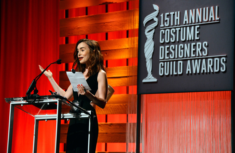 Description of . Presenter Lily Collins speaks onstage during the 15th Annual Costume Designers Guild Awards with presenting sponsor Lacoste at The Beverly Hilton Hotel on February 19, 2013 in Beverly Hills, California.  (Photo by Frazer Harrison/Getty Images for CDG)
