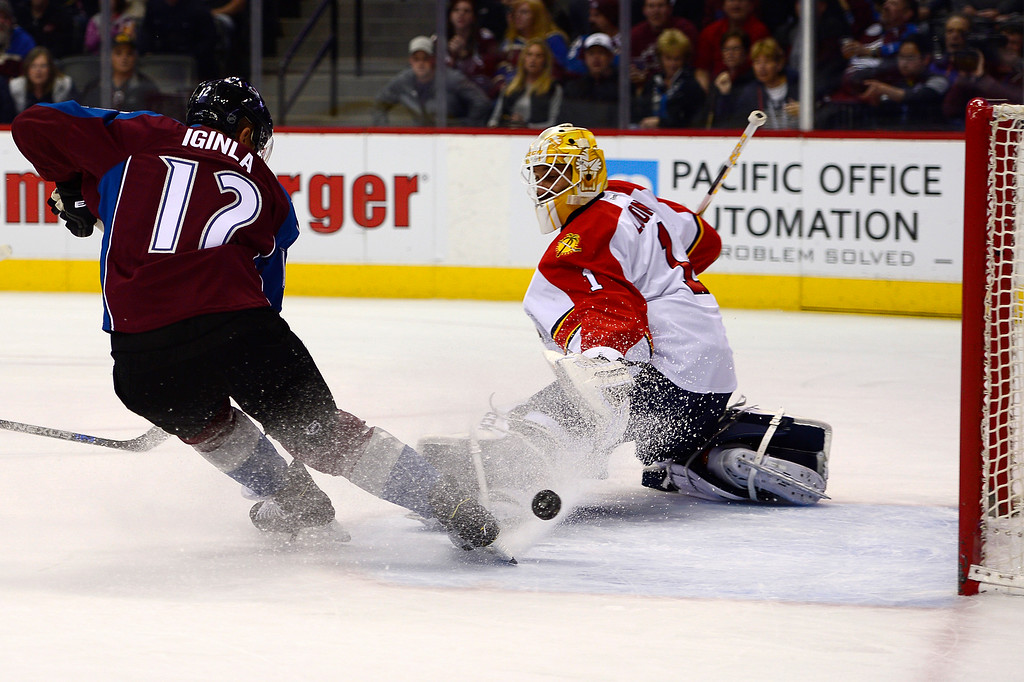 . DENVER, CO - MARCH 3: Colorado Avalanche right wing Jarome Iginla (12) tries to sneak a shot around Florida Panthers goalie Roberto Luongo (1) during the first period at the Pepsi Center on March 3, 2016 in Denver, Colorado. (Photo by Brent Lewis/The Denver Post)