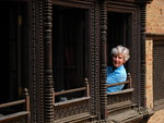 Sharon peaks out her window at Newa Chen