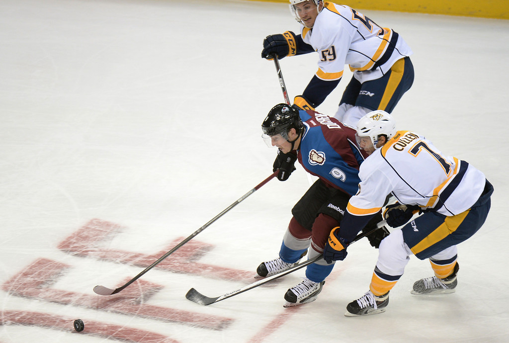 . DENVER, CO - OCTOBER 04 : Matt Duchene of Colorado Avalanche (9) controls the puck against Roman Josi (59) and Matt Cullen (7) of Nashville Predators in the 1st period of the game at Pepsi Center. Denver, Colorado. October 4, 2013. (Photo by Hyoung Chang/The Denver Post)