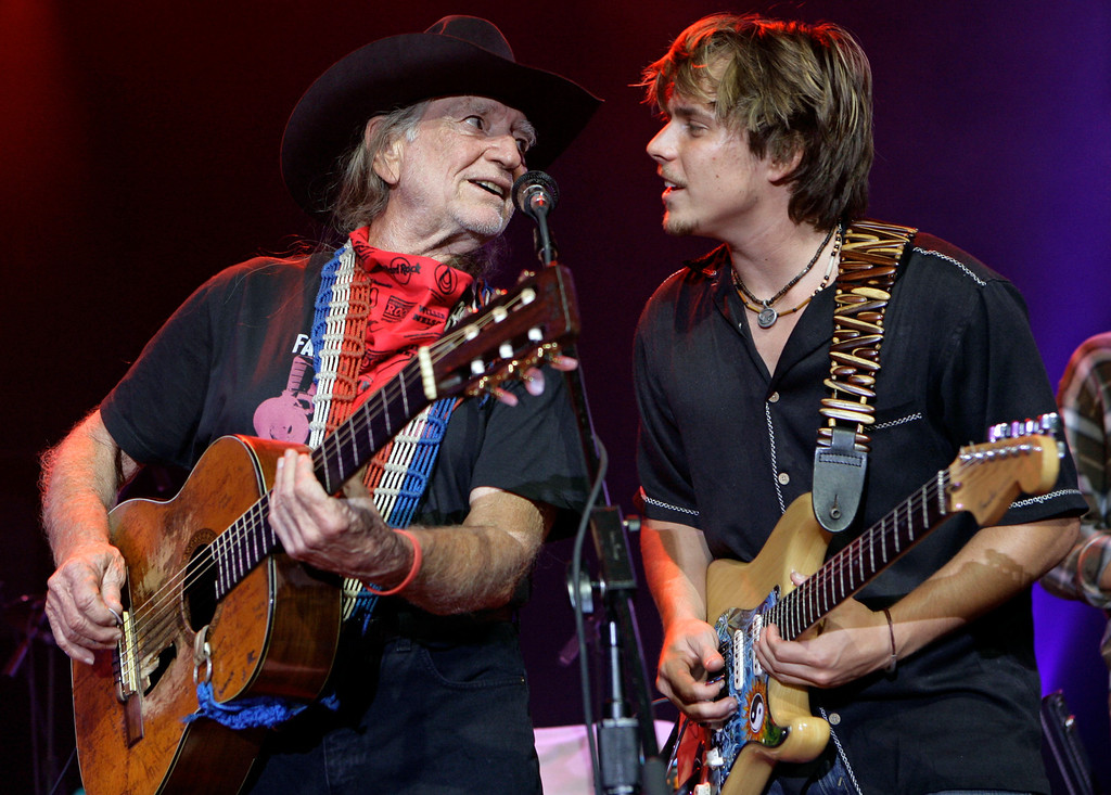 . In this photo released by Hard Rock International, Willie Nelson performs with his son Lukas Nelson at the Hard Rock Cafe as part of Hard Rock\'s Ambassadors of Rock concert tour featuring Willie Nelson and Friends, Monday, Sept. 10, 2007, in New York.  (AP Photo/Hard Rock Cafe, Stuart Ramson)