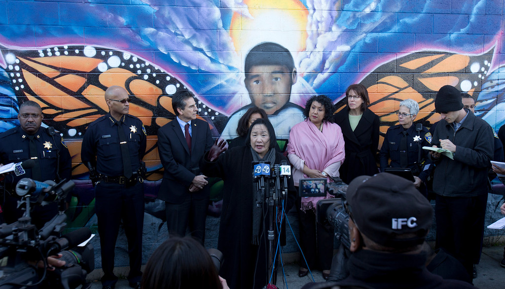. Oakland, Calif. Mayor Jean Quan, at microphones, speaks to the media at a press conference to discuss the recent spate of gun violence in the city and the police department\'s proposed response, Monday, Jan. 14, 2013 in Oakland. Police Chief Howard Jordan, second from left, City Council member Noel Gallo, community activist Lorrain Taylor, partially hidden, City Administrator Deanna Santana and City Council member Pat Kernighan also attended. (D. Ross Cameron/Staff)