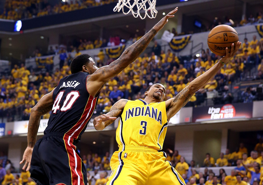 . George Hill #3 of the Indiana Pacers goes to the basket as Udonis Haslem #40 of the Miami Heat defends during Game Two of the Eastern Conference Finals of the 2014 NBA Playoffs at at Bankers Life Fieldhouse on May 20, 2014 in Indianapolis, Indiana.   (Photo by Andy Lyons/Getty Images)