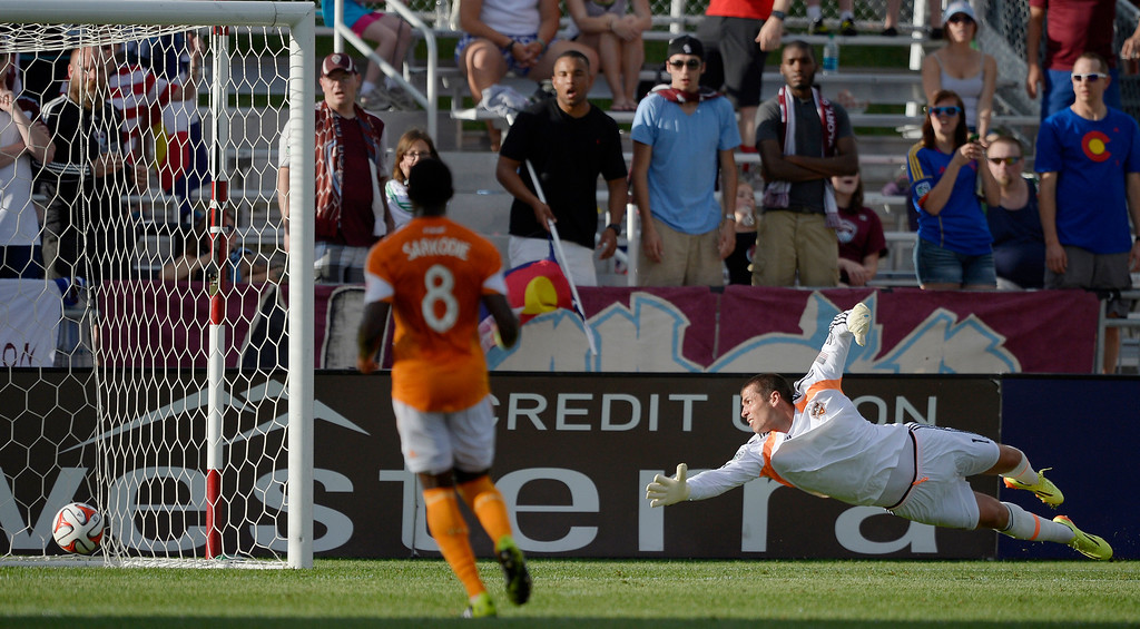 . Houston Dynamo goalkeeper Tally Hall (1) stretches out as he watches the ball hit the back of the goal on a shot by Colorado Rapids forward Deshorn Brown (26) for his second goal of the night during the first half June 1, 2014 at Dick\'s Sporting Goods Park. (Photo by John Leyba/The Denver Post)