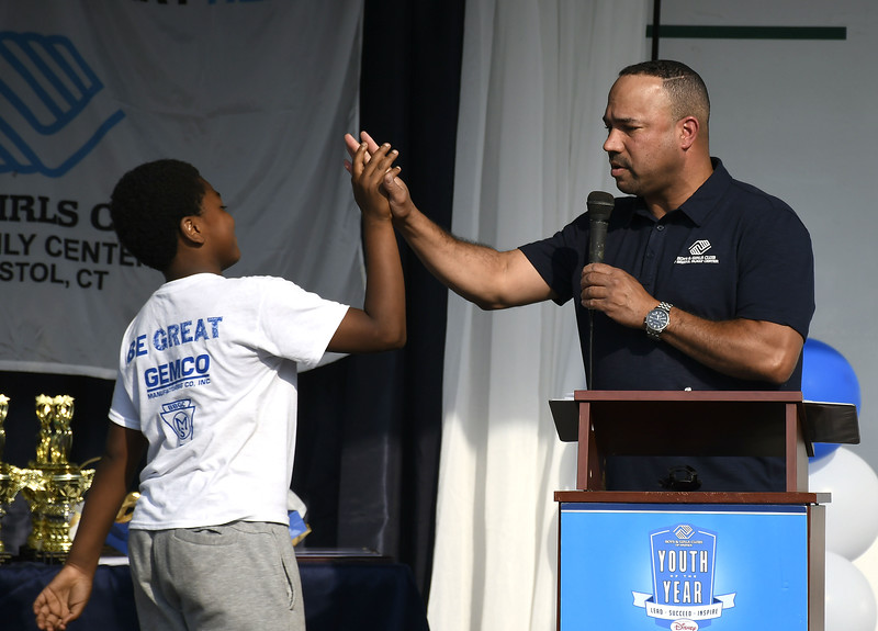 6/7/2018 Mike Orazzi | Staff Nelson Riley and Cambridge Park Unit Director Jay Maia high five each other during the Reach for the Stars held in Bristol's Cambridge Park Thursday evening.