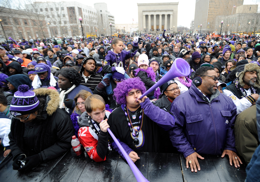 . Baltimore Ravens fans blow horns during a victory ceremony at City Hall Tuesday, Feb. 5, 2013 in Baltimore. The Ravens defeated the San Francisco 49ers in NFL football\'s Super Bowl XLVII 34-31 on Sunday. (AP Photo/Gail Burton)(AP Photo/Gail Burton)