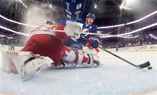 . Tampa Bay Lightning center Brian Boyle (11) beats Detroit Red Wings goalie Petr Mrazek (34) for a shorthanded goal during the first period of Game 1 of an NHL hockey first-round playoff series, Thursday, April 16, 2015, in Tampa, Fla. (Dirk Shadd/Tampa Bay Times, Dirk Shadd)