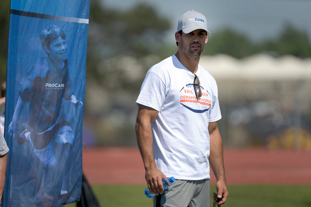 . Eric Decker looks on during camp drills. Demaryius Thomas and Eric Decker team up with ProCamps for their football camp held at Littleton High School July 11, 2013. (Photo By John Leyba/The Denver Post)