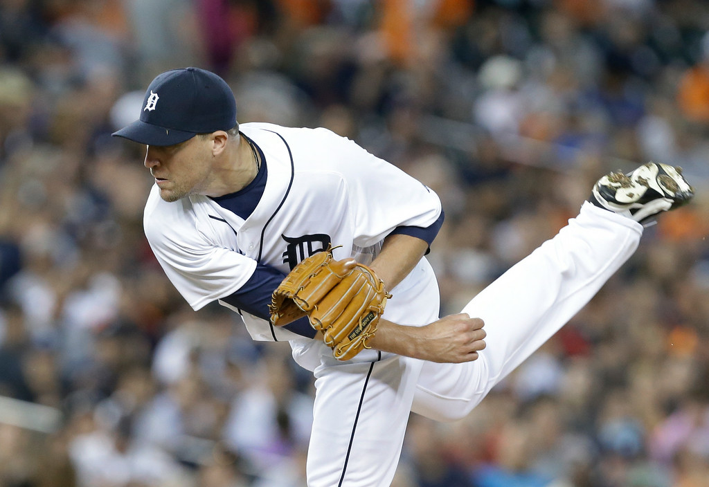 . Detroit Tigers relief pitcher Jim Johnson throws against the New York Yankees in the eighth inning of a baseball game in Detroit Wednesday, Aug. 27, 2014. (AP Photo/Paul Sancya)