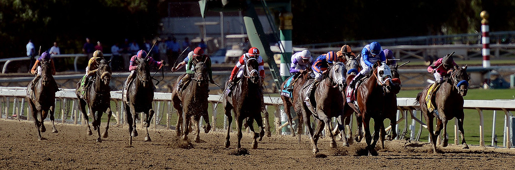 ". Jockey Martin Garcia, right, atop ""New Year\'s Day\"" (4) wins the Breeders\' Cup Juvenile eighth race during the Breeders\' Cup at Santa Anita Park in Arcadia, Calif., on Saturday, Nov. 2, 2013.    (Keith Birmingham Pasadena Star-News)"