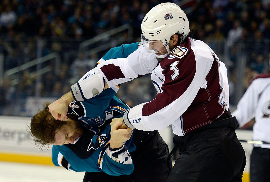 . SAN JOSE, CA - JANUARY 26:  Ryan O\'Byrne #3 of the Colorado Avalanche fights with Brad Stuart #7 of the San Jose Sharks during the first period of their game at HP Pavilion on January 26, 2013 in San Jose, California.  (Photo by Thearon W. Henderson/Getty Images)