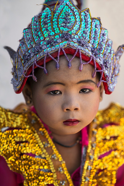 A young boy dressed up for the novice ceremony.  Myanmar, 2017.