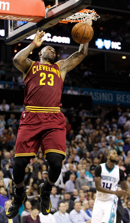 . Cleveland Cavaliers forward LeBron James dunks against the Charlotte Hornets during the second half of an NBA basketball game Wednesday, Feb. 3, 2016, in Charlotte, N.C. Charlotte won 106-97. (AP Photo/Nell Redmond)