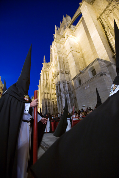 Hooded penitents entering Seville's cathedral, Holy Week 2008, Spain