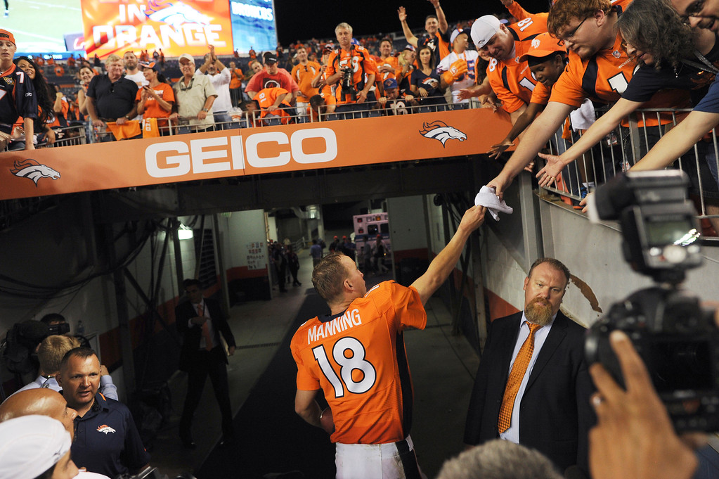 . Denver Broncos quarterback Peyton Manning (18) greets fans after the Broncos defeated the Ravens 49-24. Denver Broncos Baltimore Ravens September 5, 2013 at Sports Authority at Mile High. (Photo by Joe Amon/The Denver Post)