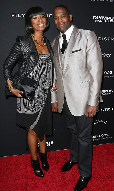 """. Actress Tasha Smith (L) and her guest attend the Premiere of FilmDistrict\'s \""""Olympus Has Fallen\"""" at the ArcLight Cinemas Cinerama Dome on March 18, 2013 in Hollywood, California.  (Photo by Frederick M. Brown/Getty Images)"""