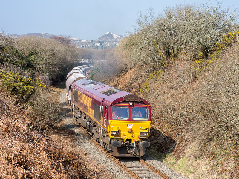 180315  The assistant mans the tripod and captures 66090 deep in the heart of Clay country.....