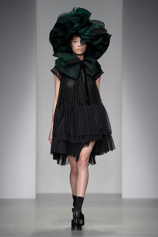 . A model wears a design created by John Rocha during London Fashion Week Autumn/Winter 2014, at Somerset House in central London, Saturday, Feb. 15, 2014. (Photo by Jonathan Short/Invision/AP)