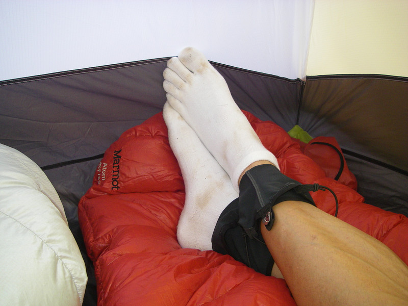 Resting in the tent here. .. Brett has really pale feet or foot gloves - your call.
