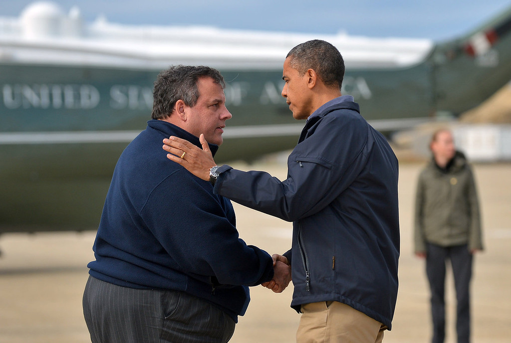 . US President Barack Obama (R) is greeted by New Jersey Governor Chris Christie upon arriving in Atlantic City, New Jersey, on October 31, 2012 to visit areas hardest hit by the unprecedented cyclone Sandy. Americans sifted through the wreckage of superstorm Sandy on Wednesday as millions remained without power. The storm carved a trail of devastation across New York City and New Jersey, killing dozens of people in several states, swamping miles of coastline, and throwing the tied-up White House race into disarray just days before the vote. AFP PHOTO/Jewel Samad