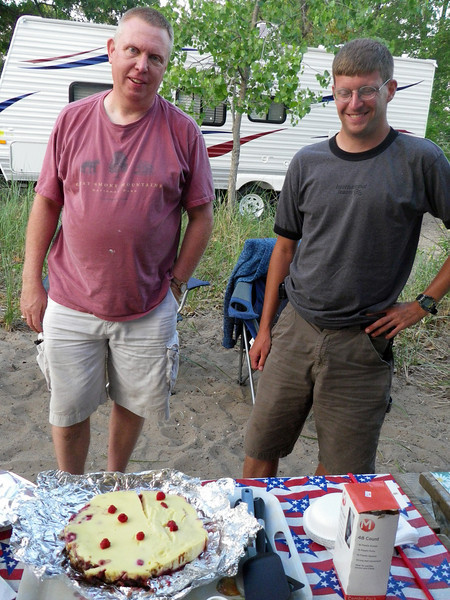 Ron and Eric show off dessert made in dutch oven