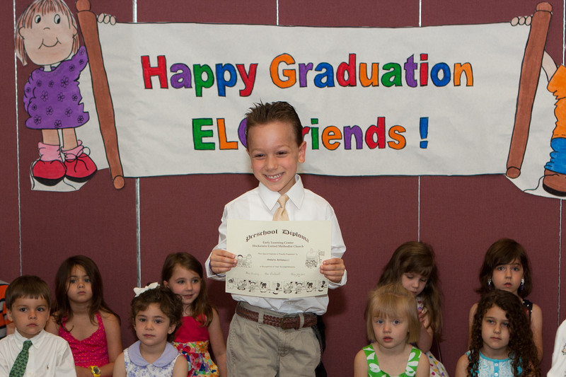 Amleto proudly displays his diploma.