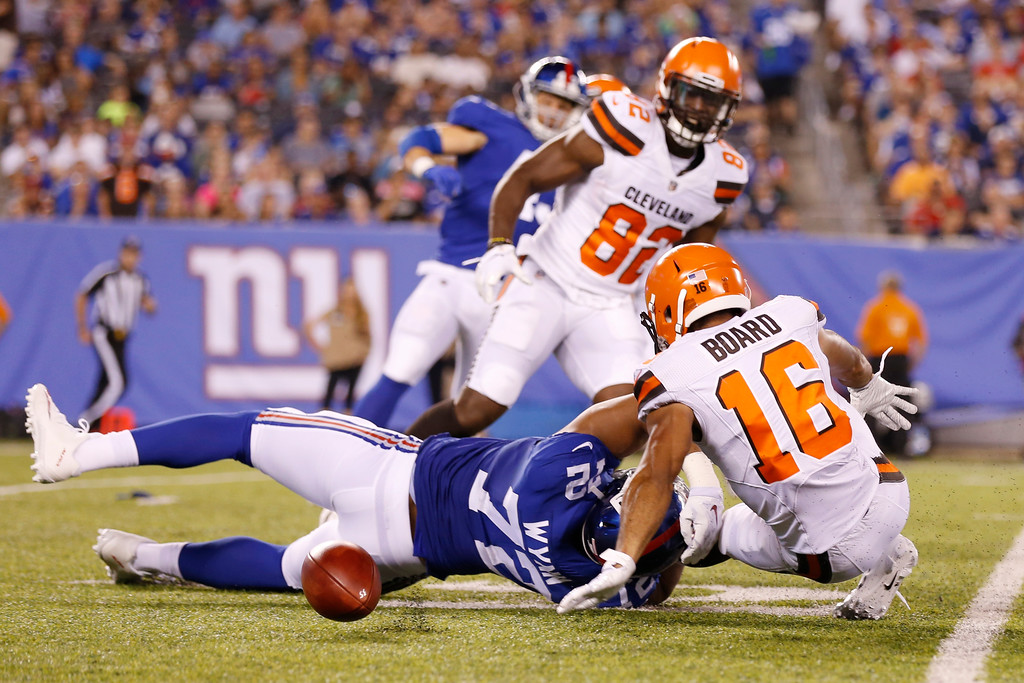 . Cleveland Browns C.J. Board (16) fumbles as he is hit by New York Giants\' Kerry Wynn (72) during the second half of a preseason NFL football game Thursday, Aug. 9, 2018, in East Rutherford, N.J. The Giants recovered the fumble. (AP Photo/Adam Hunger)