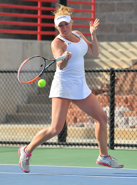 LAS VEGAS, NV - JANUARY 20:  Lindsay Harlas of the New Mexico State Aggies plays a forehand during her team's doubles match against Caitlin Herb and Pei-Hsuan (Patty) Kuo of the Weber State Wildcats at the Frank and Vicki Fertitta Tennis Complex in Las Vegas, Nevada. New Mexico State won the doubles match 6-3.