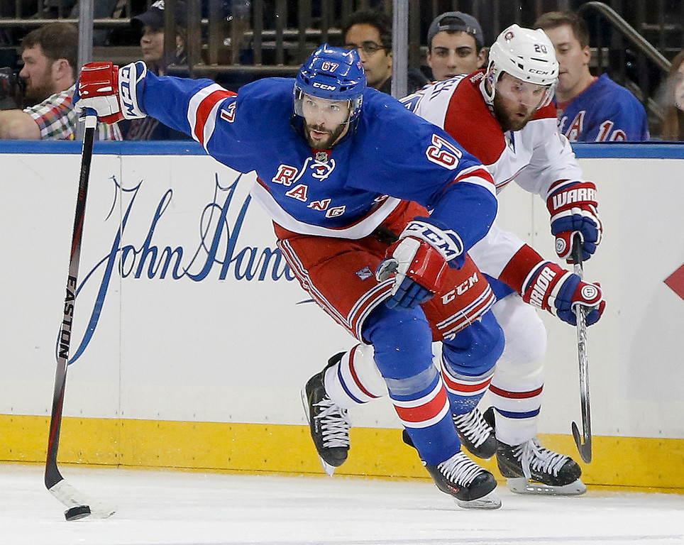 . New York Rangers left wing Benoit Pouliot (67) looks to pass the puck off against Montreal Canadiens left wing Thomas Vanek (20) during the second period in Game 6 of the NHL hockey Stanley Cup playoffs Eastern Conference finals, Thursday, May 29, 2014, in New York. (AP Photo/Kathy Willens)