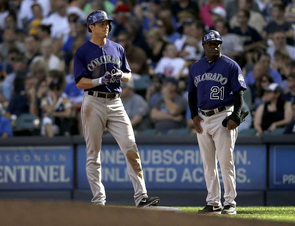 . MILWAUKEE, WI - JUNE 28: Drew Stubbs #13 of the Colorado Rockies stands at first base after hitting a RBI single in the top of the sixth inning against the Milwaukee Brewers at Miller Park on June 28, 2014 in Milwaukee, Wisconsin. (Photo by Mike McGinnis/Getty Images)