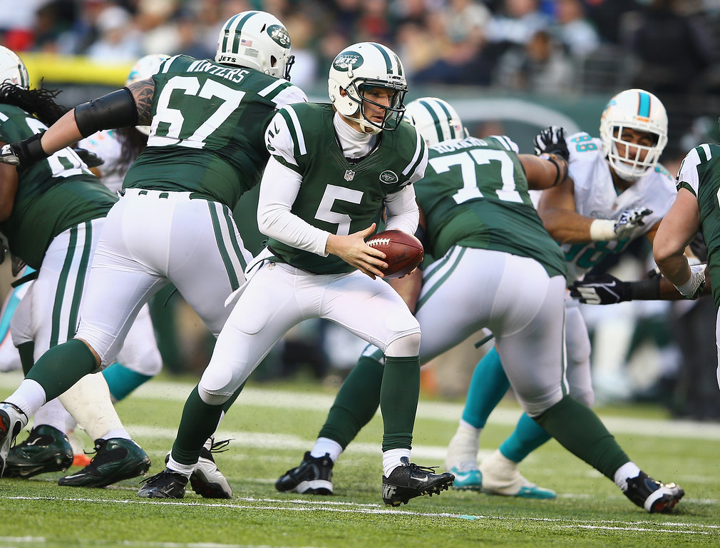 . Matt Simms #5 of the New York Jets looks to hand off the ball against the Miami Dolphins during their game at MetLife Stadium on December 1, 2013 in East Rutherford, New Jersey.  (Photo by Al Bello/Getty Images)