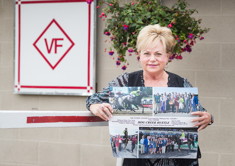 Vicki with win picture of Hog Creek Hustle from this year's G1 Woody Stephens Stakes.