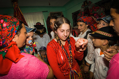Europe, Romania, Transylvania, Gypsy wedding,  wedding party at bride's home , teenage bride is leaving her home for good