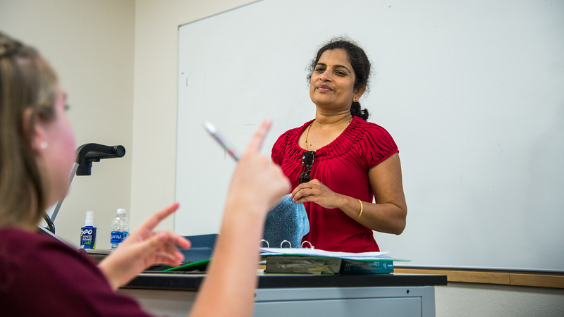 Instructor Archana Krishnagiri listen to the student's answer in Business Mathematics class