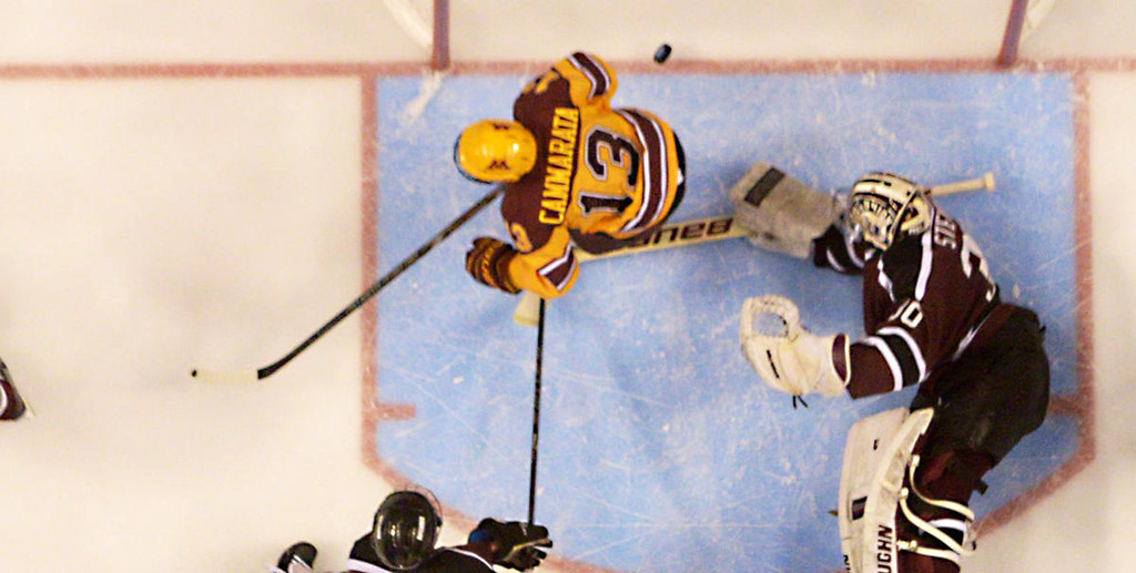 . Minnesota freshman forward Taylor Cammarata skates past the goal after a Minnesota freshman forward Justin Kloos goal against Union College junior goalie Colin Stevens in the first period of the NCAA Frozen Four Championship Game at the Wells Fargo Center in Philadelphia, Saturday, April 12, 2014. Union College beat the Gophers 7-4 to claim the national championship.  (Pioneer Press: John Autey)