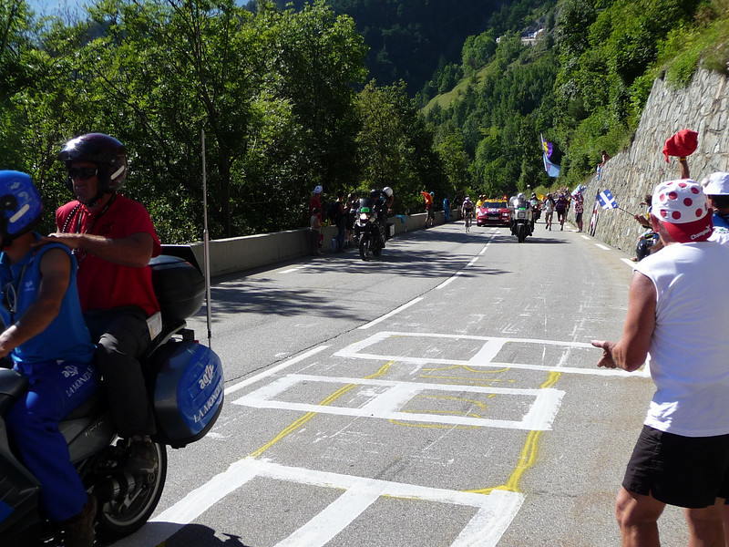 The first riders show up. Location - Alpe d'Huez