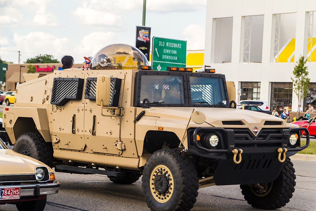 Description of . Aside from the classic cars, sports cars, The General Lee and the Batmobile, some military trucks could also be found driving up and down Woodward. Photo by Dylan Dulberg