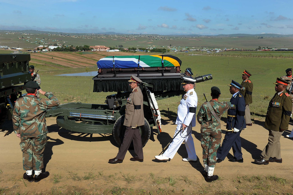 . The coffin of South African former president Nelson Mandela is escorted by the military to the compound for his funeral ceremony in Qunu on December 15, 2013. Mandela, the revered icon of the anti-apartheid struggle in South Africa and one of the towering political figures of the 20th century, died in Johannesburg on December 5 at age 95.  ELMOND-JIYANE/AFP/Getty Images