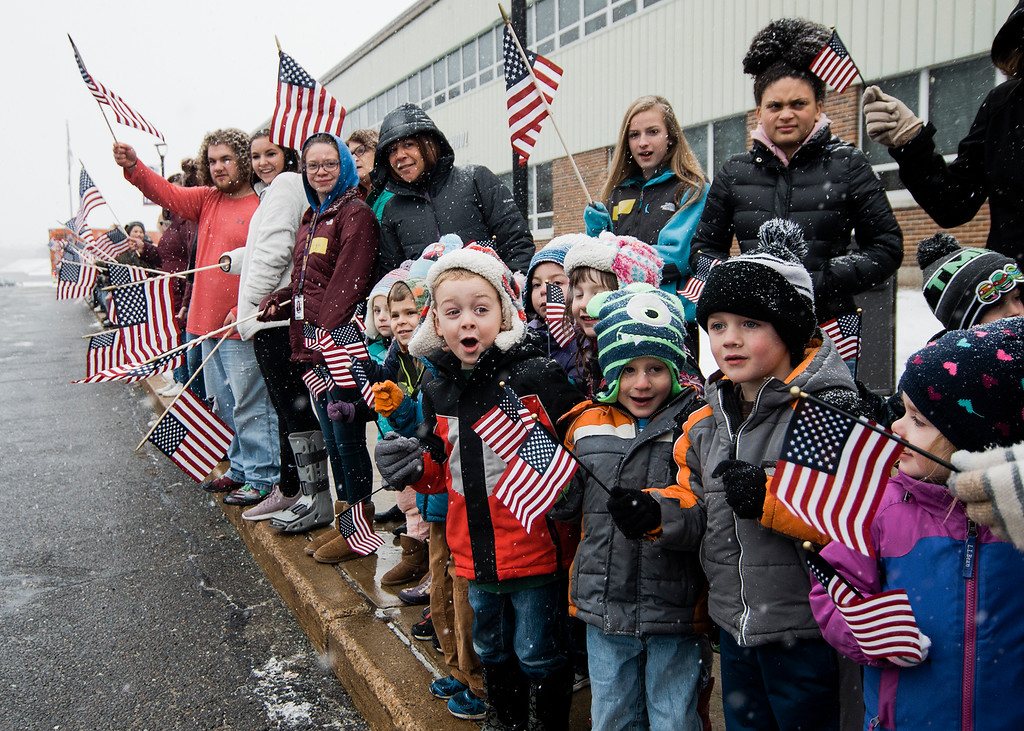 . Monty Tech students greet the Wreaths Across America Convoy at the school, which was chosen as one of two stops in Massachusetts, as it traveled from Maine to Arlington National Cemetery on Tuesday, December 12, 2017. Wreaths Across America aims to remember fallen veterans by placing wreaths upon their graves every December. SENTINEL & ENTERPRISE / Ashley Green