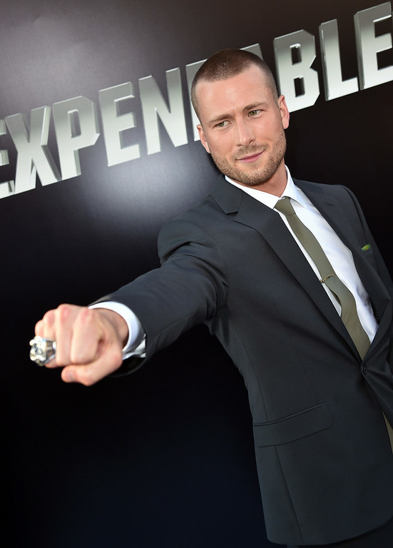 ". Actor Glen Powell attends the premiere of Lionsgate Films\' ""The Expendables 3\"" at TCL Chinese Theatre on August 11, 2014 in Hollywood, California.  (Photo by Kevin Winter/Getty Images)"