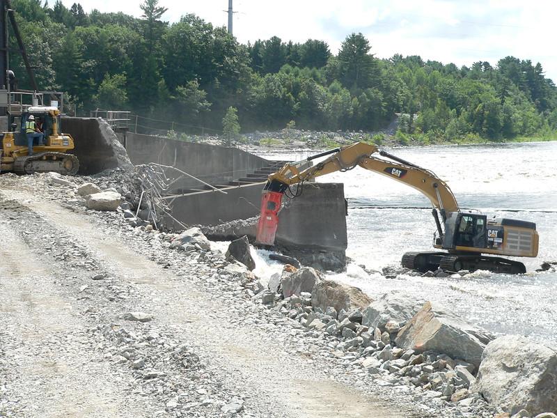 NPK GH23 hydraulic hammer on CAT excavator Maine Dam Demolition (7).JPG