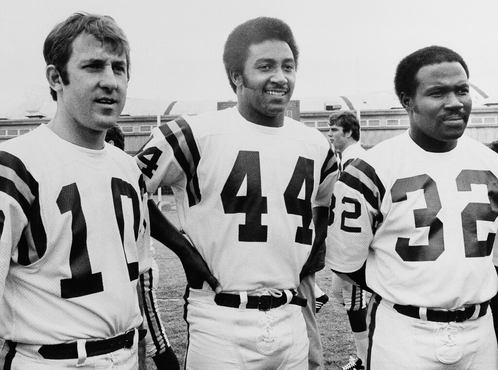 . MINNESOTA VIKINGS - Fran Tarkenton, the veteran Minnesota Vikings quarterback, poses with running backs Chuck Foreman (44) and Oscar Reed (32) during team workout and picture day on Monday, Jan. 7, 1974, in Houston.  (AP Photo)
