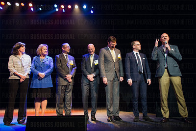 Outstanding Voices recipient John Rubino (right), president of GreenRubino, speaks as other Outstanding Voices honorees listen during the Puget Sound Business Journal's The Business Of Pride at the Paramount Theatre in Seattle on Thursday, May 26, 2016. (BUSINESS JOURNAL PHOTO | Dan DeLong)
