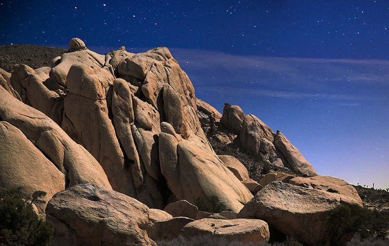 Oyster Bar on Ryan Mountain under the night sky in Joshua Tree National Park.