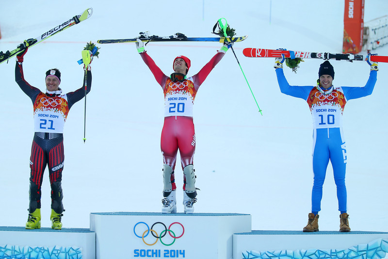 . (L-R) Silver medalist Ivica Kostelic of Croatia, gold medalist Sandro Viletta of Switzerland and bronze medalist Christof Innerhofer of Italy celebrate during the flower ceremony for the Alpine Skiing Men\'s Super Combined Downhill on day 7 of the Sochi 2014 Winter Olympics at Rosa Khutor Alpine Center on February 14, 2014 in Sochi, Russia.  (Photo by Clive Rose/Getty Images)